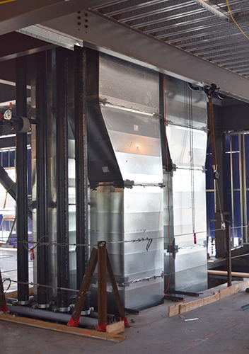 Riser duct carries supply and return air between floors.