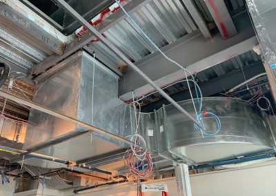 Inside ductwork that ties into roof curb.